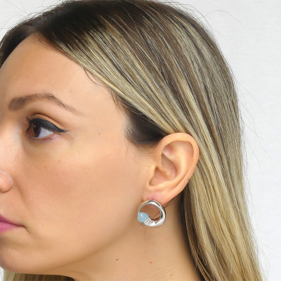 Stud earrings with aquamilk crystals and zircons