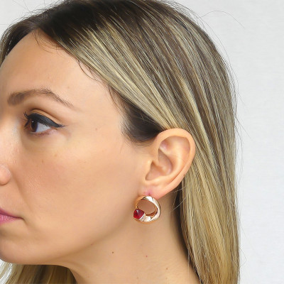 Stud earrings with ruby crystals and zircons