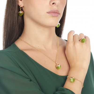 Ring with pendant crystal in olivine color