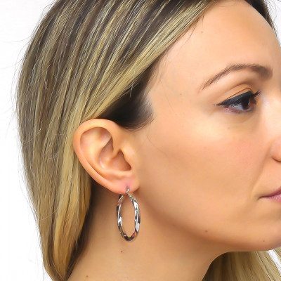 Large silver torchon earrings