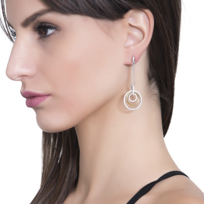 Two-tone pendant earrings with concentric circles and zircons