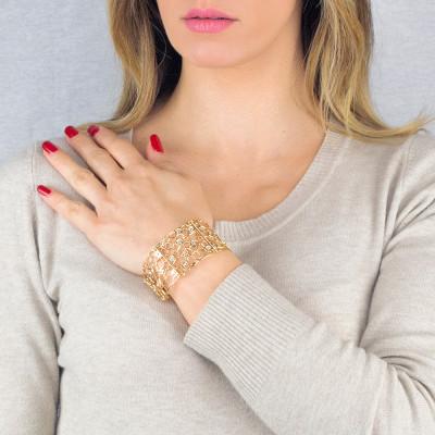 Semi-rigid golden bracelet with mesh and Swarovski texture