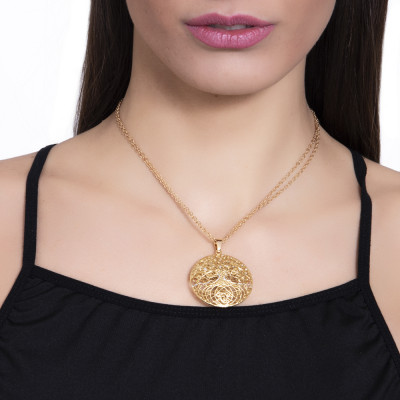 Golden necklace with circular pendant and tree of life in silver glitter