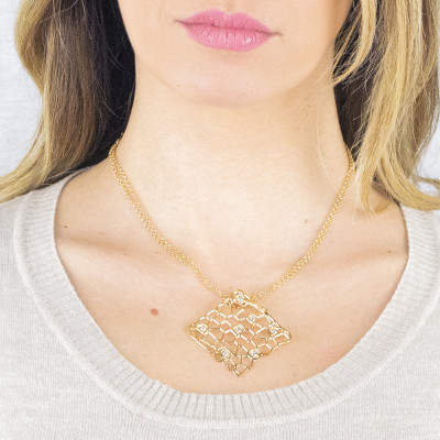 Long golden necklace with a network and Swarovski texture pendant