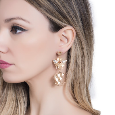 Earrings with hanging bees and beehive decorations