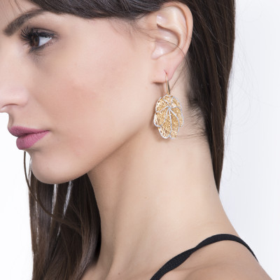Golden earrings with silver glitter leaf