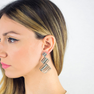 Rhodium-plated dangling earrings decorated by Swarovski