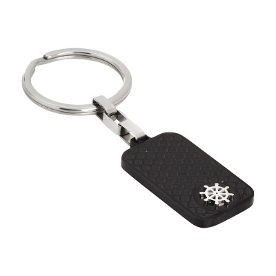 Key ring with carbon fiber surface and rhodium rudder