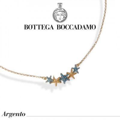 Yellow gold plated necklace with central light blue starfish