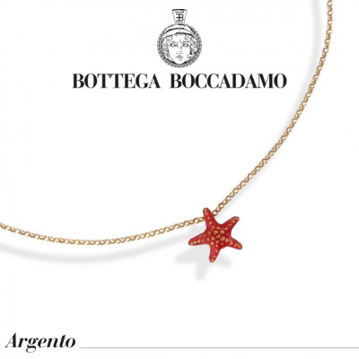 Yellow gold-plated necklace with coral-colored starfish pendant