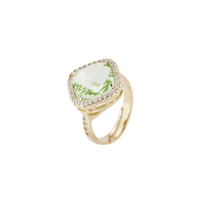 Ring with crystal chrysolite briolette and zircons
