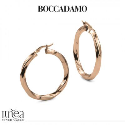 Big pink bronze torchon earrings
