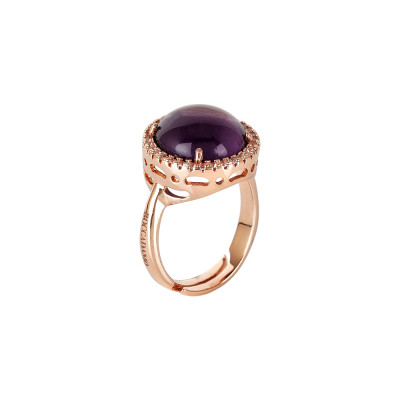 Ring with flecked amethyst cabochon crystal and zircons