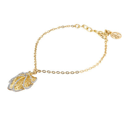 Golden bracelet with leaf charm in silver glitter